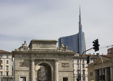 Milan Between history and Modernity. MILAN, ITALY - MAY 10: Milan Between history and Modernity. The Porta Nuova ancient arch and the new glass skyscraper behind Royalty Free Stock Photography