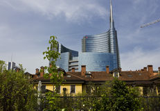 Milan between history and Modernity. MILAN, ITALY: Milan between history and Modernity. Traditional milanese historic house in the foreground with the new modern Stock Image