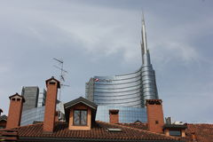 Milan between history and Modernity. MILAN, ITALY: Milan between history and Modernity. Traditional milanese historic house in the foreground with the new modern Stock Photo