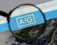 Milan Italien - Augusti 10, 2017: AIG websitehomepage Det är ett A Royaltyfria Foton