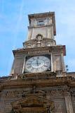 Milan, Italiy. Giureconsulti palace decoration. Clock tower. Royalty Free Stock Photography