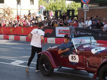 Milan, Italy - August 29, 2018: Charles Leclerc jumping on his historical car for an exhibition stock photography