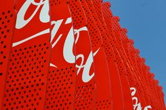 Coca Cola pavilion decoration with branded wooden images of Coca Cola red bottles. stock photos