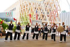 Iranian folklore dancers are dancing with passion in front of the Iran pavilion at EXPO Milano 2015. royalty free stock photography