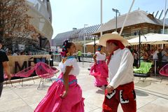 Mexican folklore dancers are dancing with passion in front of the Mexico pavilion at EXPO Milano 2015. stock image