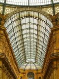 Glass ceiling of The Vittorio Emanuele II Gallery and tourists in the Dome Square in Milan, Italy. Milan, Italy - Ceiling of The Vittorio Emanuele II Gallery and Royalty Free Stock Photos