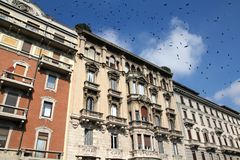 Milan, Italy. City view. Black ominous birds in the sky Royalty Free Stock Photography