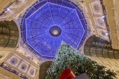 Christmas lights and Xmas tree under Galleria roof at. MILAN, ITALY - DECEMBER 7: Christmas lights and Xmas tree under Galleria roof at `La Scala` premiere time Royalty Free Stock Images