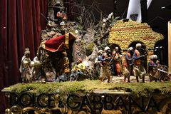 Dolce & Gabbana boutique window decorated for Christmas holidays with original Neapolitan creche. Milan/Italy - December 31, 2015: Close-up view to the Dolce & stock photography