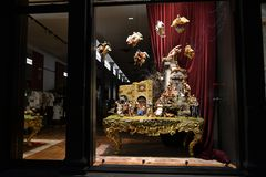 Dolce & Gabbana boutique window decorated for Christmas holidays with original Neapolitan creche. Milan/Italy - December 31, 2015: Close-up view to the Dolce & royalty free stock photos
