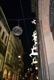 Running white deers and the street golden clock of the Rolex boutique decorated for the Christmas holidays. stock photography