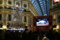 Milan, Italy - People watch the gala season opener of La Scala opera house on a giant screen in Galleria Vittorio Emanuele II stock image
