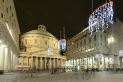 Xmas time lights at san Carlo church, Milan, Italy. MILAN, ITALY - DECEMBER 7: view of old san Carlo church and its Classic column arcade in Vittorio Emanuele Stock Images
