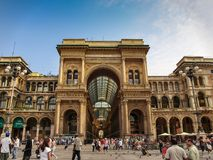 Entrance of The Vittorio Emanuele II Gallery and tourists in the Dome Square in Milan, Italy. Milan, Italy - Entrance of The Vittorio Emanuele II Gallery and Stock Photography