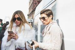 Fashionable people posing during Milan Women`s Fashion Week royalty free stock photos