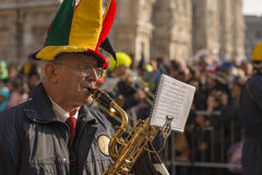 Old sax player in parade, Milan Royalty Free Stock Images