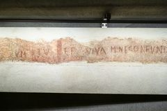 Inscription in archaeological area in Milan Duomo royalty free stock photos