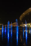 Milan, Italy, Financial district night view. Illuminated water f Stock Photos