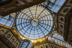 Milan, Italy. The Galleria Vittorio Emanuele II, one of the world`s oldest shopping malls. Housed within a four-story double arcade, it is named after the first Stock Photo