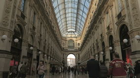 Milan, Italy inside Galleria Vittorio Emanuele II. This arcade is from its opening in 1877 one of the oldest shopping malls in Europe stock video footage