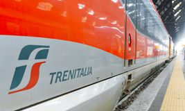 Close up of Trenitalia train at Milan`s Central Station, a major rail hub in northern Italy with connections throughout royalty free stock photography
