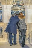 Adult couple watching the view of milan city. MILAN, ITALY, JANUARY - 2018 - Adult couple watching the view of milan city from duomo cathedral viewpoint royalty free stock images