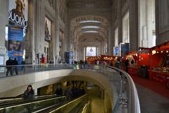 External escalator and decorated with red kiosks large corridor of the Milan Central railway station. stock photos