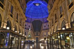 Beautiful inside panoramic view to the Vittorio Emanuele II Gallery with giant blue crest made of Swarovski crystals and cafes. stock photography