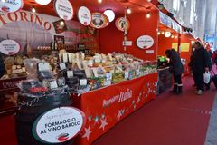 Traditional Italian Christmas market stalls decorated with red fabric inside Milan Central. royalty free stock photography
