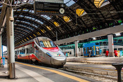 MILAN, ITALY - JULY 14, 2016. Milan Central Station high speed train Trenitalia Frecciarossa, red arrow. Royalty Free Stock Images