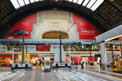MILAN, ITALY - JULY 19, 2017: Milan Central Station interior view with passengers with suitcases , Milan, Italy Royalty Free Stock Photos