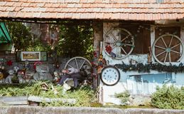 Milan ITALY - July 2018 - strange house with stuffed animal and watch in abandoned place Martesana channel Milan. stock image