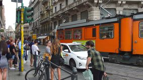 Milan, Italy - July 19, 2017: view from Piazza del Duomo square with typical tram of Milan passing in rush hour, Milan, Italy.  stock video footage