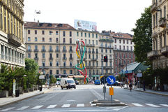 MILAN, ITALY - JULY 19, 2017: view on via Marco Minghetti street from Sforza Castle with the public artwork of Claes Oldenburg Nee Stock Image