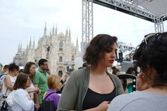 Beauticians receiving customers for free outdoors photo set `Brosway` in Milan Duomo square. royalty free stock photography
