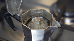 Italian espresso coffee made in a mocha stock footage