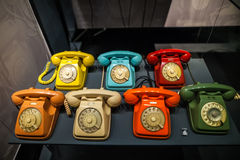 MILAN, ITALY - JUNE 9, 2016: multicoloured old phones at the Sci Royalty Free Stock Images