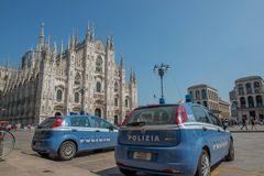 Police in Milan square. Milan Italy June 29, 2019: Police car in Piazza Duomo in Milan to control and prevent the danger of attacks on the cathedral stock photography