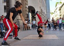 MILAN, ITALY - JUNE 1: Street acrobats are performing in CORSO VITTORIO EMANUELE  Milan Royalty Free Stock Photo