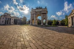 Triumph Arc - Arco Della Pace in Sempione park, Milan, Italy. MILAN, ITALY - JUNE 22, 2018: Triumph Arc - Arco Della Pace in Sempione park at sunset time Royalty Free Stock Image
