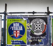 Election posters on billboard ahead of Italian General Election to be held on March 4th, 2018 - CasaPound Italy is a neo. Milan, Italy - Mar 2nd, 2018: Election Royalty Free Stock Image