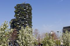 Milan - Bosco Verticale residential tower,trees in bloom in a sunny day of spring, Porta Nuova district , Italy stock images