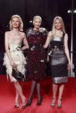 MILAN, ITALY - MARCH 02: Eva Herzigova, Nadja Auermann and Claudia Schiffer attend the Extreme Beauty In Vogue party at the Palazz Royalty Free Stock Photo