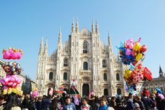Duomo square of Milan crowded by people celebrating Carnival event royalty free stock photos