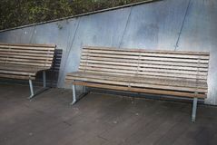 Wood park bench. Milan, Italy - March 09, 2018: Wood park bench in Porta Nuova stock photography
