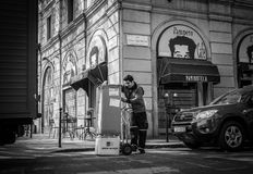 Milan, Italy - March 23, 2016: Worker unload  big boxes using th. E Hand truck on the italian street in Milan, Italy Stock Images