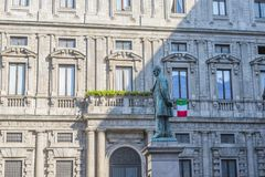 Early morning at square of San Fedele, statue of the writer Alessandro Manzoni royalty free stock photos
