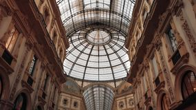 Milan, Italy - May 2019: Glass ceiling and dome in the Vittorio Emanuele gallery. Slow motion.  stock footage