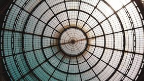 Milan, Italy - May 2019: Glass dome gallery Vittorio Emanuele. The concept of symmetry. All-round panorama.  stock video footage