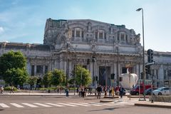 Milan, Italy - 10 May 2018: Milan Central Station -Stazione Centrale- and the square in front of the station. People. Cross the road. Summer morning stock images